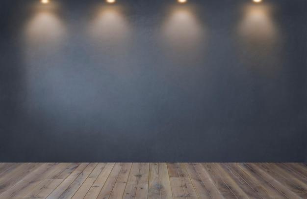 Muro grigio scuro con una fila di faretti in una stanza vuota Foto Gratuite