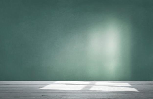 Muro verde in una stanza vuota con pavimento in cemento Foto Gratuite