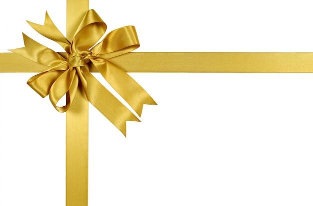 Nastro e fiocco regalo legati a mano in oro giallo Foto Gratuite