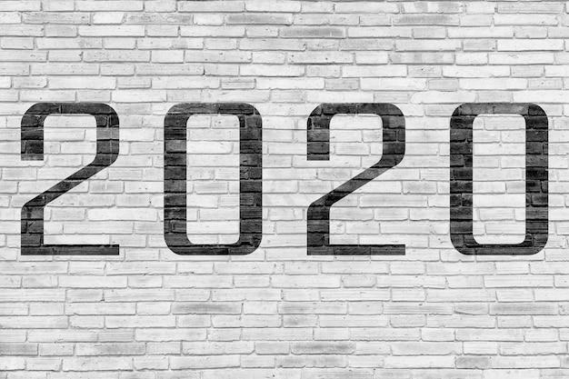 Numero 2020 sul muro di mattoni Foto Premium