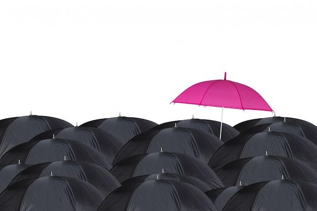 Ombrello rosa tra ombrelli neri Foto Gratuite