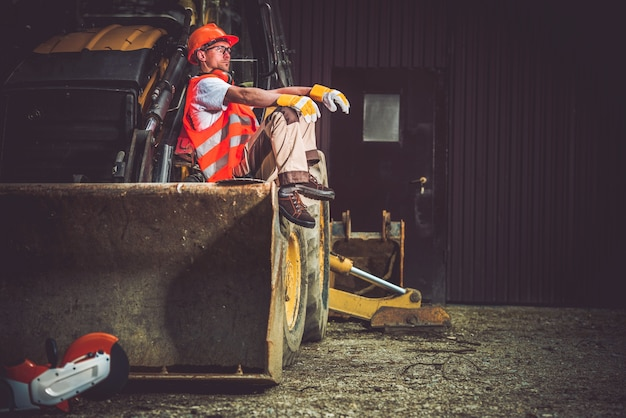 Operatore di escavatori bulldozer Foto Gratuite