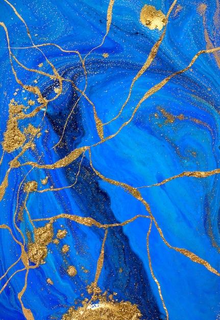Oro liquido astratto e vernice blu. Foto Premium