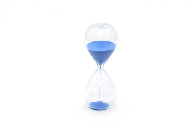 Orologio di sabbia blu isolato su bianco Foto Premium