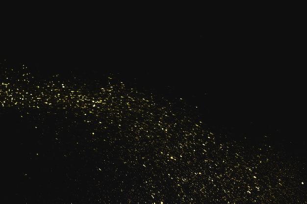 Paillettes che cadono su sfondo scuro Foto Gratuite