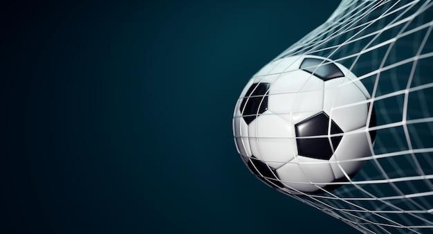 Pallone da calcio in rete su sfondo blu scuro. Foto Premium