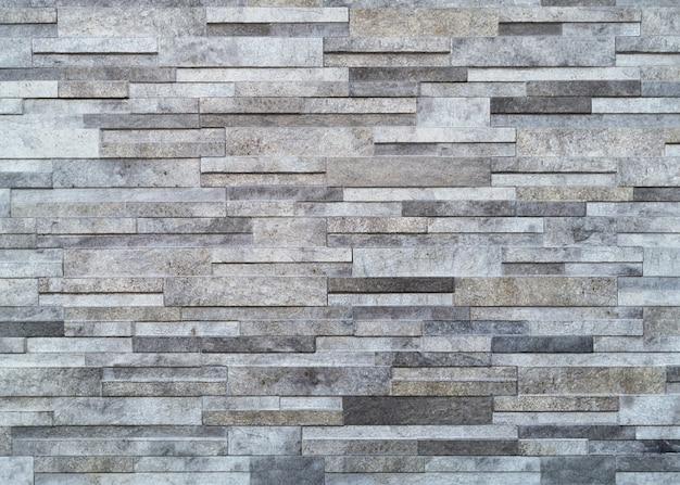 Parete bianca superficiale dei toni del grigio muro di pietra Foto Gratuite