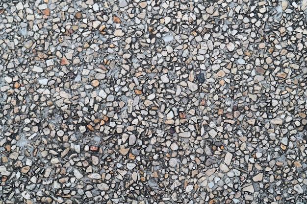 Pavimento del ciottolo di lerciume come fondo strutturato senza cuciture. piccoli ciottoli mescolati con sabbia Foto Premium