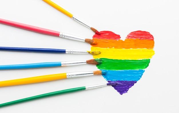 Pennelli arcobaleno di vernice per orgoglio amore Foto Gratuite