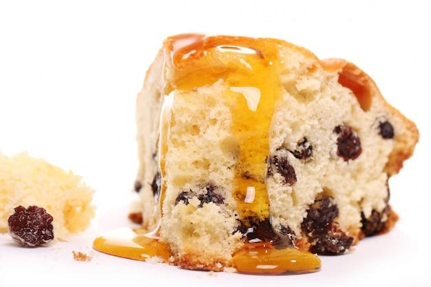 Pezzo di torta fresca con miele Foto Gratuite