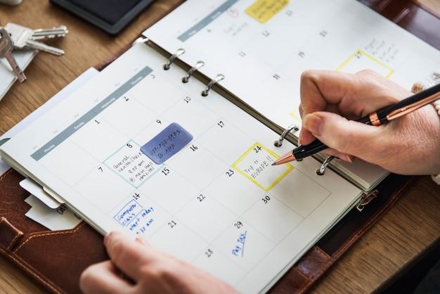 Pianifica il diario degli appunti per fare il concetto di lista Foto Premium