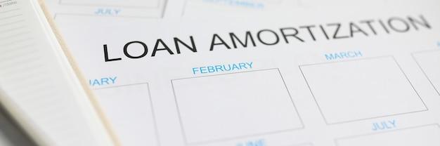 Piano di ammortamento del prestito con piano di lavoro Foto Premium