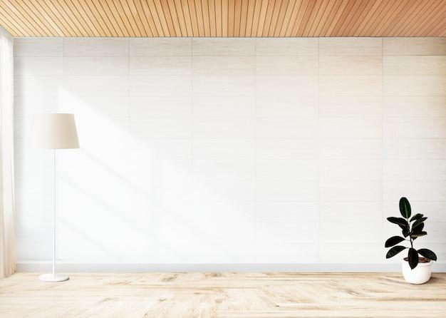 Pianta di fico di gomma in una stanza vuota Foto Gratuite