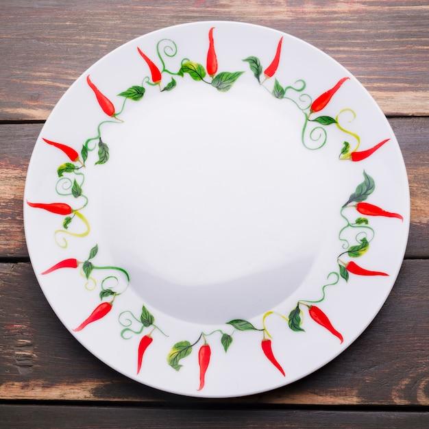 Piastra con ornamento chili Foto Gratuite