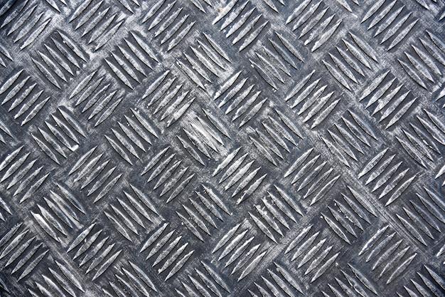 Piastra metallica con motivo a rombi, struttura in ferro. Foto Premium