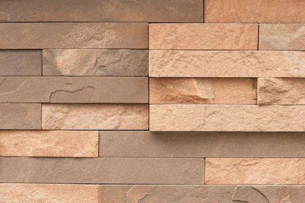 Piastrella irregolare in arenaria per la superficie della parete Foto Gratuite