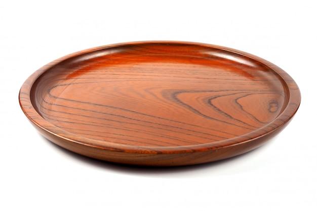 Piatto di legno rotondo vuoto, piatto di legno marrone Foto Premium