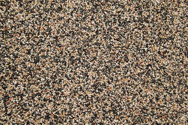 Piccola pietra della sabbia di struttura della parete della sabbia o del fondo della parete della sabbia Foto Premium