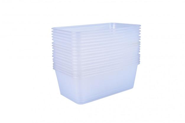 Pila di contenitore per alimenti di plastica isolato su bianco Foto Premium