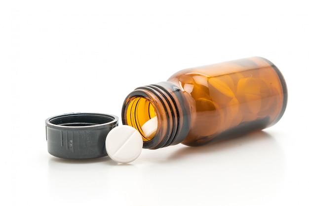 Pillole, droghe, farmacia, medicina o medica delle compresse su fondo bianco Foto Premium