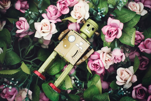 Pink rose decoration robot concept Foto Gratuite