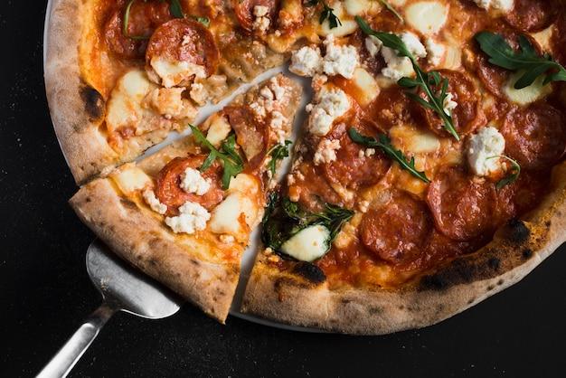 Pizza gustosa del primo piano Foto Gratuite