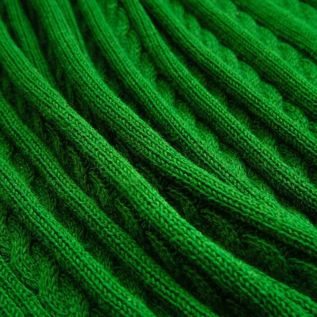 Plaid verde, codino lavorato a maglia. Foto Premium