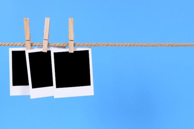 Polaroid foto di stile su una linea Foto Gratuite