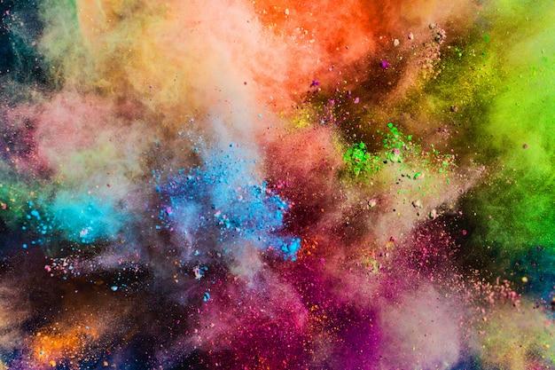 Polvere colorata che spruzza nell'aria. Foto Premium