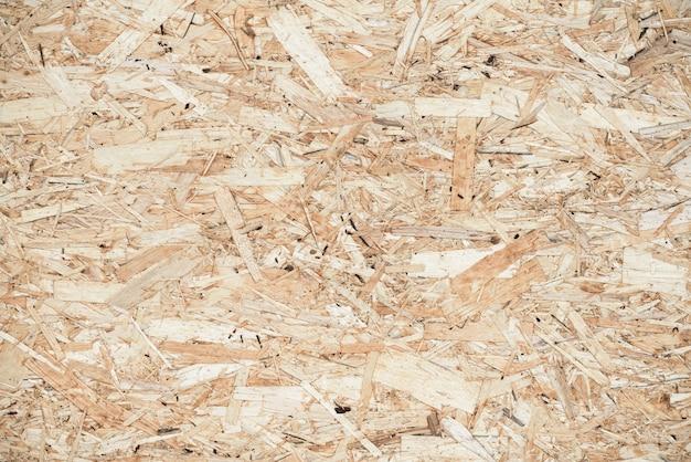 Premuto pannello di fondo in legno, struttura senza cuciture del bordo orientato del filo - osb Foto Premium