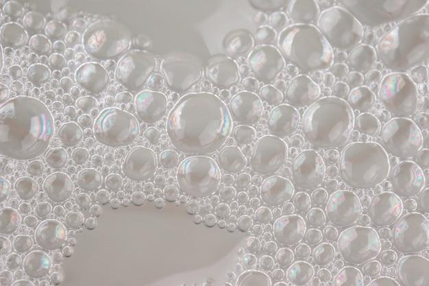 Primo piano bianco del fondo dell'estratto di struttura della schiuma Foto Premium