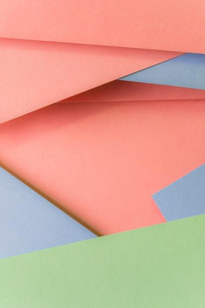 Primo piano del contesto di carta colorata pastello alla moda Foto Gratuite