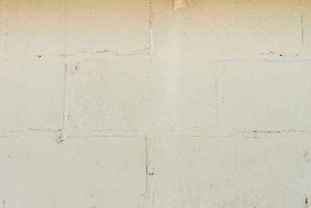 Primo piano del fondo bianco del muro di mattoni Foto Gratuite