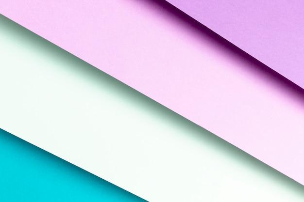 Primo piano del modello blu e viola piatto laici Foto Gratuite