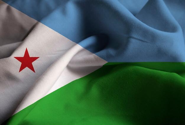 Primo piano della bandiera arruffata di gibuti, bandiera di gibuti che soffia nel vento Foto Premium