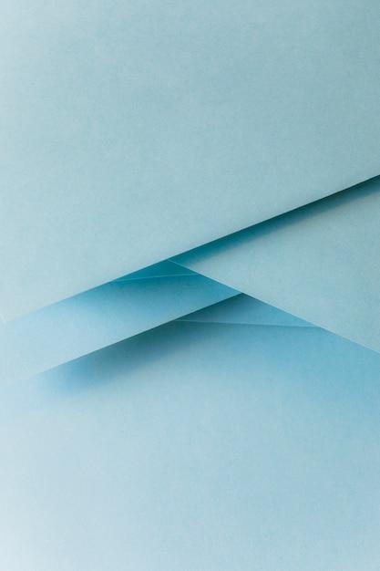 Primo piano della bandiera di carta colorata blu pastello Foto Gratuite
