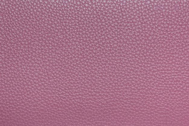 Primo piano di cuoio rosa di struttura per fondo Foto Premium