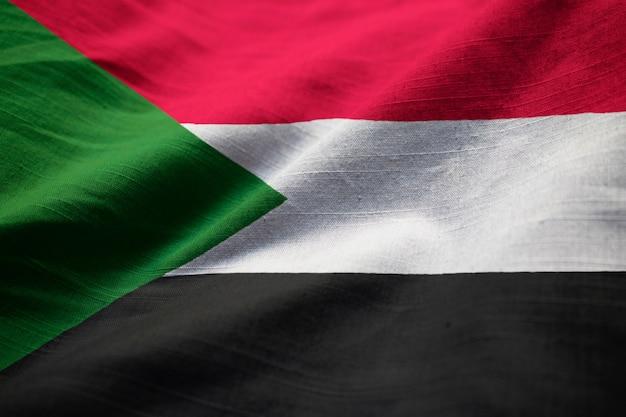 Primo piano di ruffled sudan flag, sudan flag blowing in wind Foto Premium