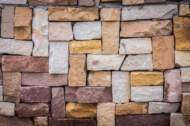 Primo piano di vecchio fondo multicolore del muro di mattoni. Foto Premium