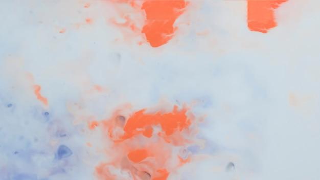 Priorità bassa arancione e blu artistica astratta della vernice Foto Gratuite