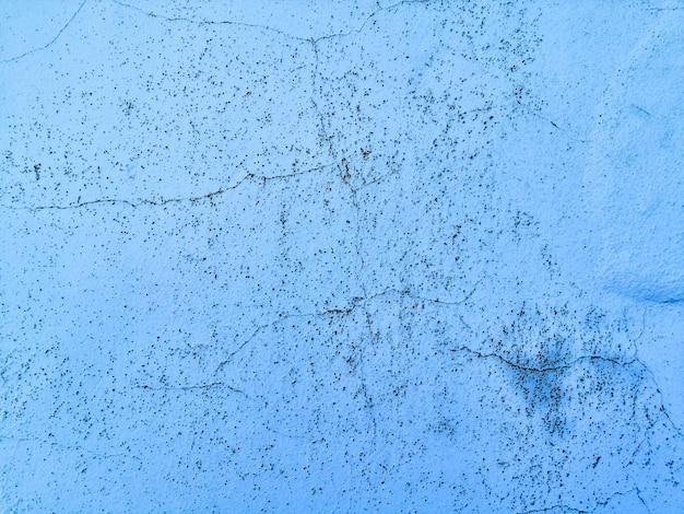 Priorità bassa blu di struttura della parete con le crepe Foto Gratuite