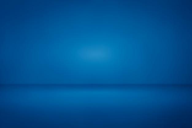 Priorità bassa chiara di pendenza della luce dello studio della stanza blu per il contesto Foto Premium