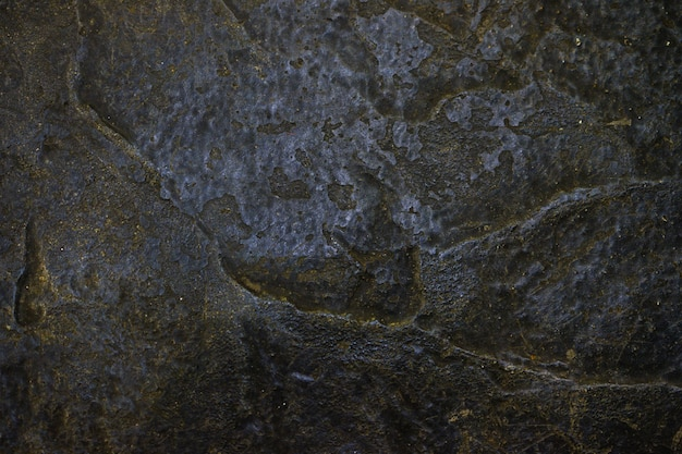 Priorità bassa di struttura della pietra o della roccia nella vista scura Foto Premium