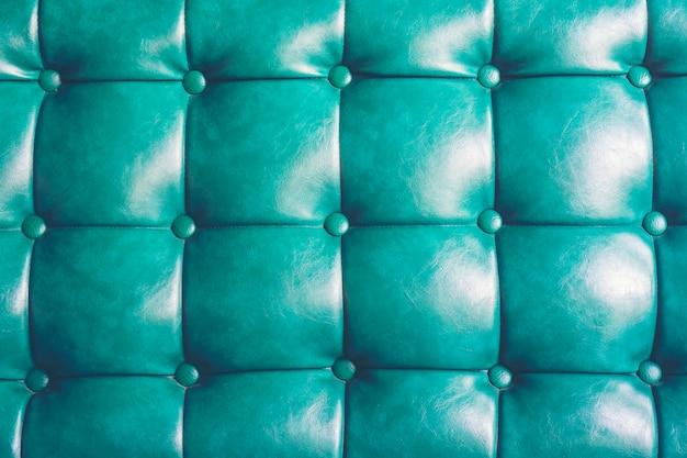 Priorità bassa di struttura in pelle blu con motivo abbottonato Foto Premium