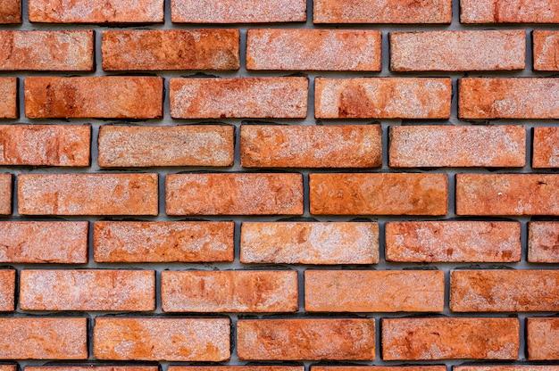 Priorità bassa e struttura della parete di mattoni rossi Foto Premium