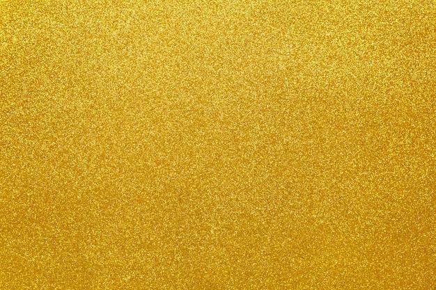 Priorità bassa festiva scintillante dell'oro, primo piano Foto Premium