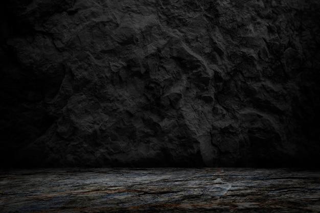 Priorità bassa scura e nera di struttura della roccia, stanza in bianco e studio per il prodotto attuale Foto Premium