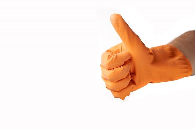 Pulizia gesto delle mani, guanto di gomma arancione, per casa, giardino, protezione. sfondo bianco isolato. Foto Premium