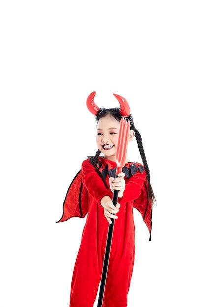 Ragazza in un diavolo del vestito operato da halloween Foto Premium