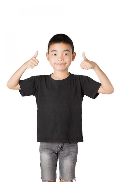 Ragazzo asiatico di sorriso, pollici in su su priorità bassa bianca Foto Premium